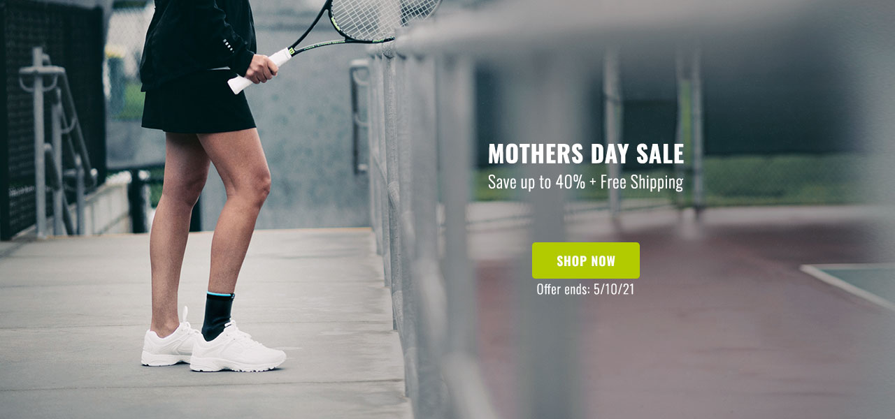 Mothers Day Sale - Save up to 40% + Free Shipping - Woman holding tennis racket with ankle support